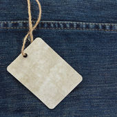 Price tag over jeans — Stock Photo