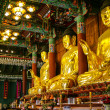 Golden buddha statues — Stock Photo