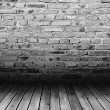 Brick wall and wood floor — Stock Photo