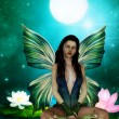 Cute fairy on a water lily leaf — Stock Photo