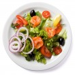 Salad with salmon served on white plate — Stock Photo