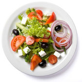 Salad served on white plate — Stock Photo