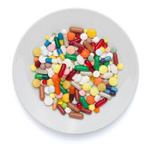 Pills, capsules and tablets on white plate — Foto Stock