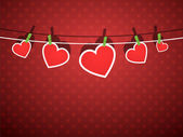 Paper hearts hanging from a rope, on red wallpaper. — Stock Vector