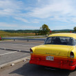 Stock Photo: 1960 Classic Yellow Car Rear view