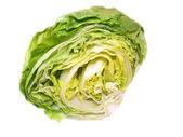 Studio shot of a whole iceberg lettuce on white background. — Stock Photo