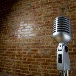 Vintage Microhone and brick wall — Stock Photo #13383097