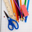 Assorted School Supplies on a lined notebook — Stock Photo #13409045