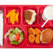 School lunch tray with food on it on a white backgrounf - Stock Photo