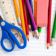Assorted School Supplies on a lined notebook — Stock Photo
