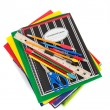 Spiral notebooks with school supplies on top — Stock Photo