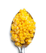 Spoonful of corn — Stock Photo