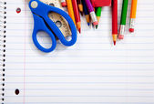 Assorted school supplies with notebooks — Stock Photo
