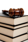 Wooden gavel on top of a stack of law books — Stock Photo