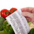 Grocery List over a bag a vegetables - Stockfoto