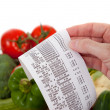 Stock Photo: Grocery List over bag vegetables