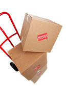 Brown cardboard moving box on white with a fragile sticker — Stock Photo