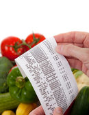 Grocery List over a bag a vegetables — Stock Photo