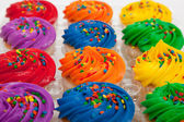Multi-colored cupcakes with sprinkles — Stock Photo
