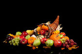 Fall arrangement of fruits and vegetables in a cornucopia — Stock Photo