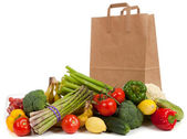 Assorted vegetables with a grocery sack — Stock Photo