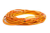 An orange extension cord on white — Stock Photo