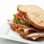 Turkey sandwich on white background — Stock Photo #13440564