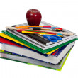 Stack of textbooks with school supplies on top — Stock Photo #13441236