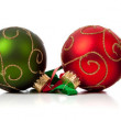 Red and Green Christmas ornaments with ribbon on white — Stock Photo
