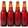 Brown bottles of beer on a white background with copy space — Stock Photo