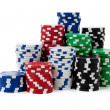 Stacks of poker chips on white — Stock Photo