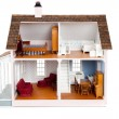 Child's doll house with furniture on white — Stock Photo #13446078