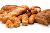 Assorted kinds of breads on a white background — Stock Photo