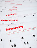 Stack of monthly calendars — Stock Photo