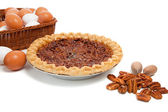 Pecan pie with ingredients on a white background — Stock Photo