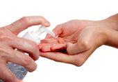Adult giving child hand sanitizer — Fotografia Stock