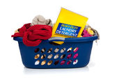 Blue laundry basket full of dirty clothes — Stock Photo