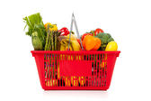 Red shopping basket with vegetables on white — Stock Photo