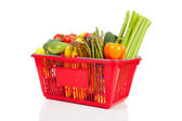 A red shopping basket with vegetables — Stock Photo