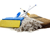 Sponge mop, broom and string mop on white — Stock Photo