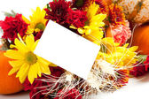 Autumn floral arrangement on white with a note back — Stock Photo