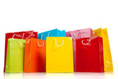 Assorted colored shopping bags on white — Stock Photo