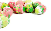 Decorated easter eggs on white with copy space — Stock Photo