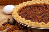 Homemade pecan pie with ingredients — Stock Photo