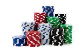 Stacks of poker chips on white — Stock Photo