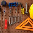 Peg board with tools and hard hat — Lizenzfreies Foto