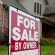 Home with a for sale sign in the yard — Stock Photo