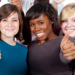 Multi-racial college students holding their thumbs up — Stock Photo #13456420