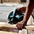Man using circular saw on wood — Stock Photo