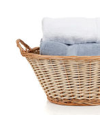 White and blue towels in a laundry basket on white with copy spa — Stock Photo